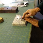 scraping the end of a piece of leather